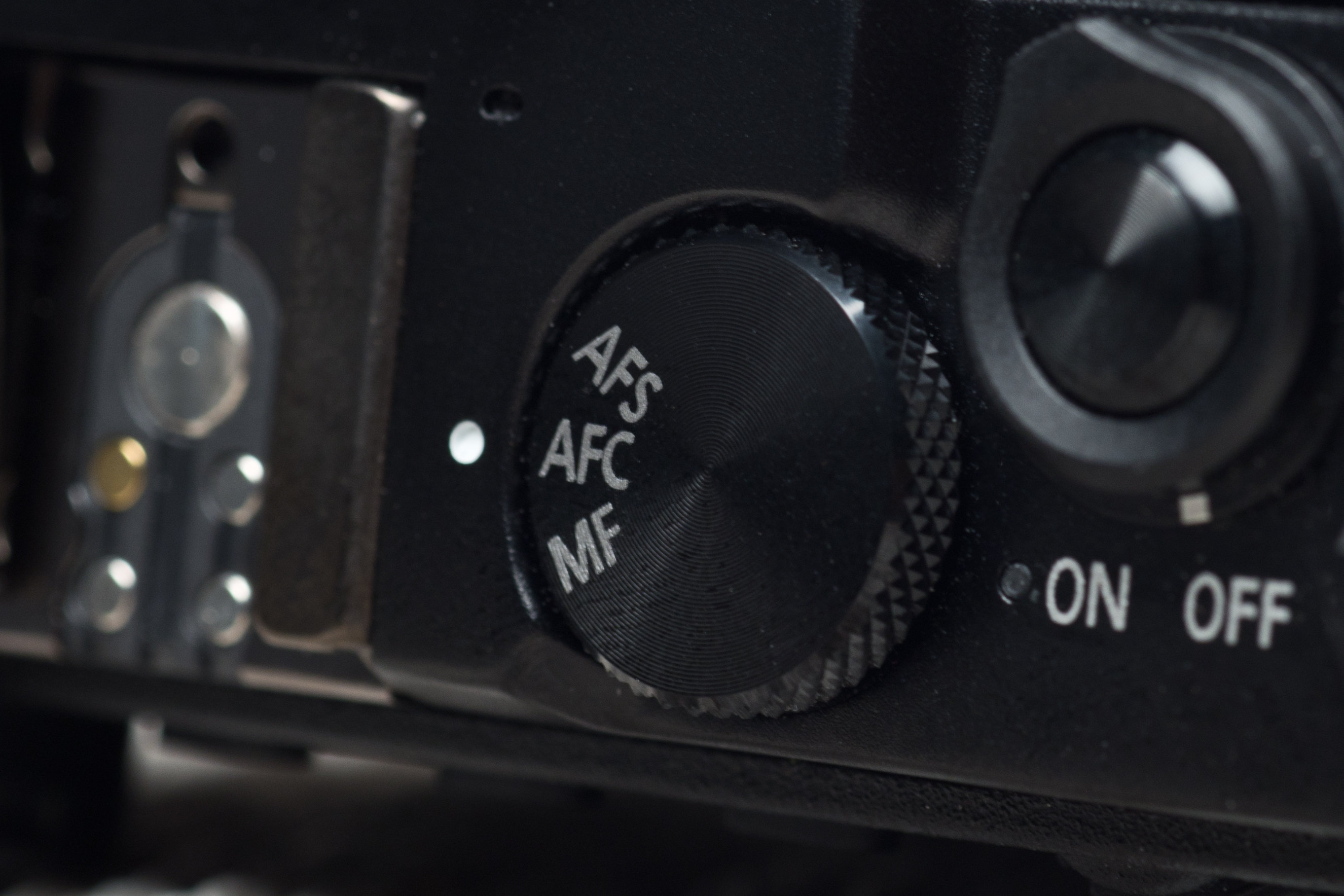 A photo of the Panasonic Lumix GM5's focus mode dial.