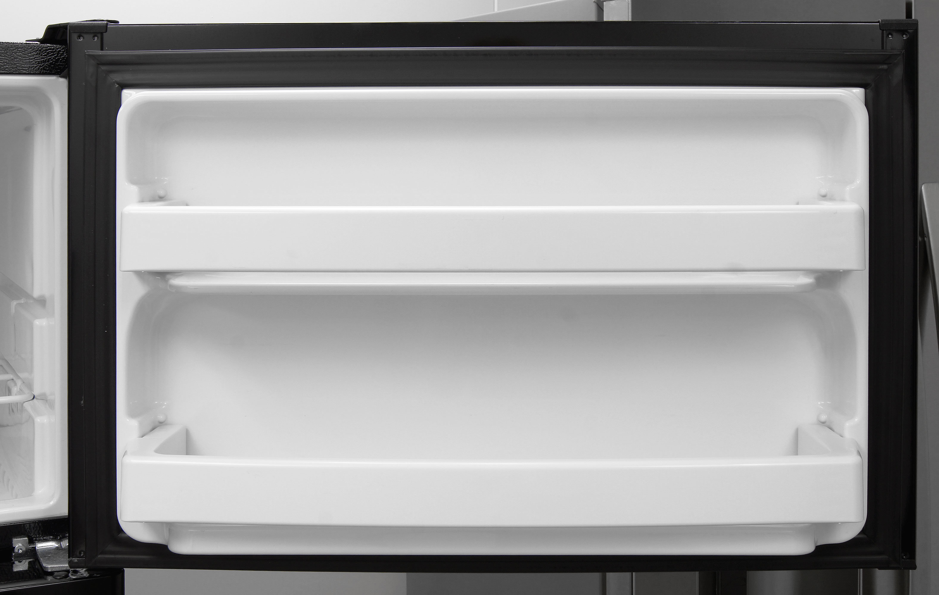 Standard fixed shelves are found on the freezer door of the GE GIE16DGHBB.