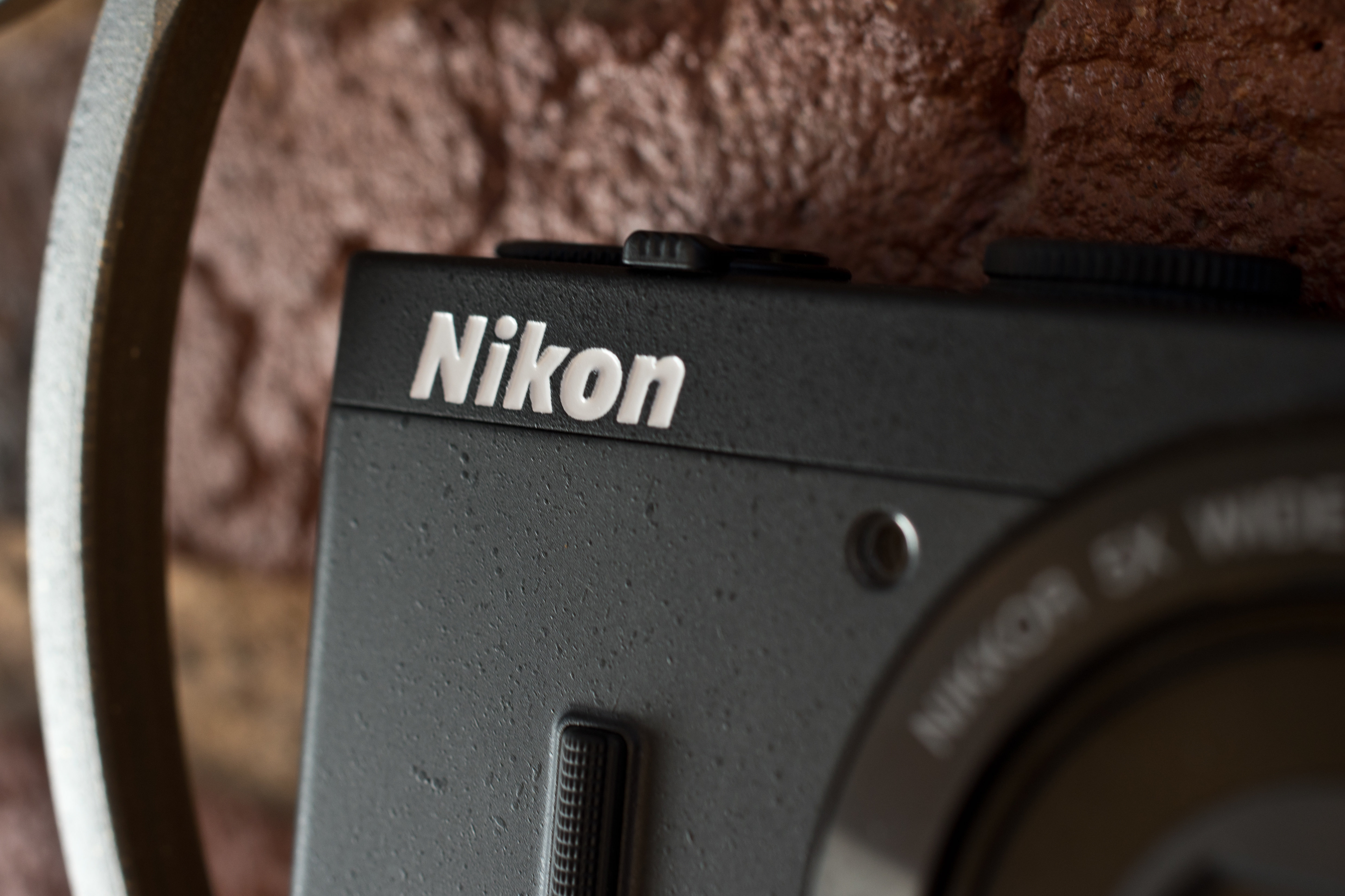 A photograph of the Nikon Coolpix P340's front logo, AF lamp.