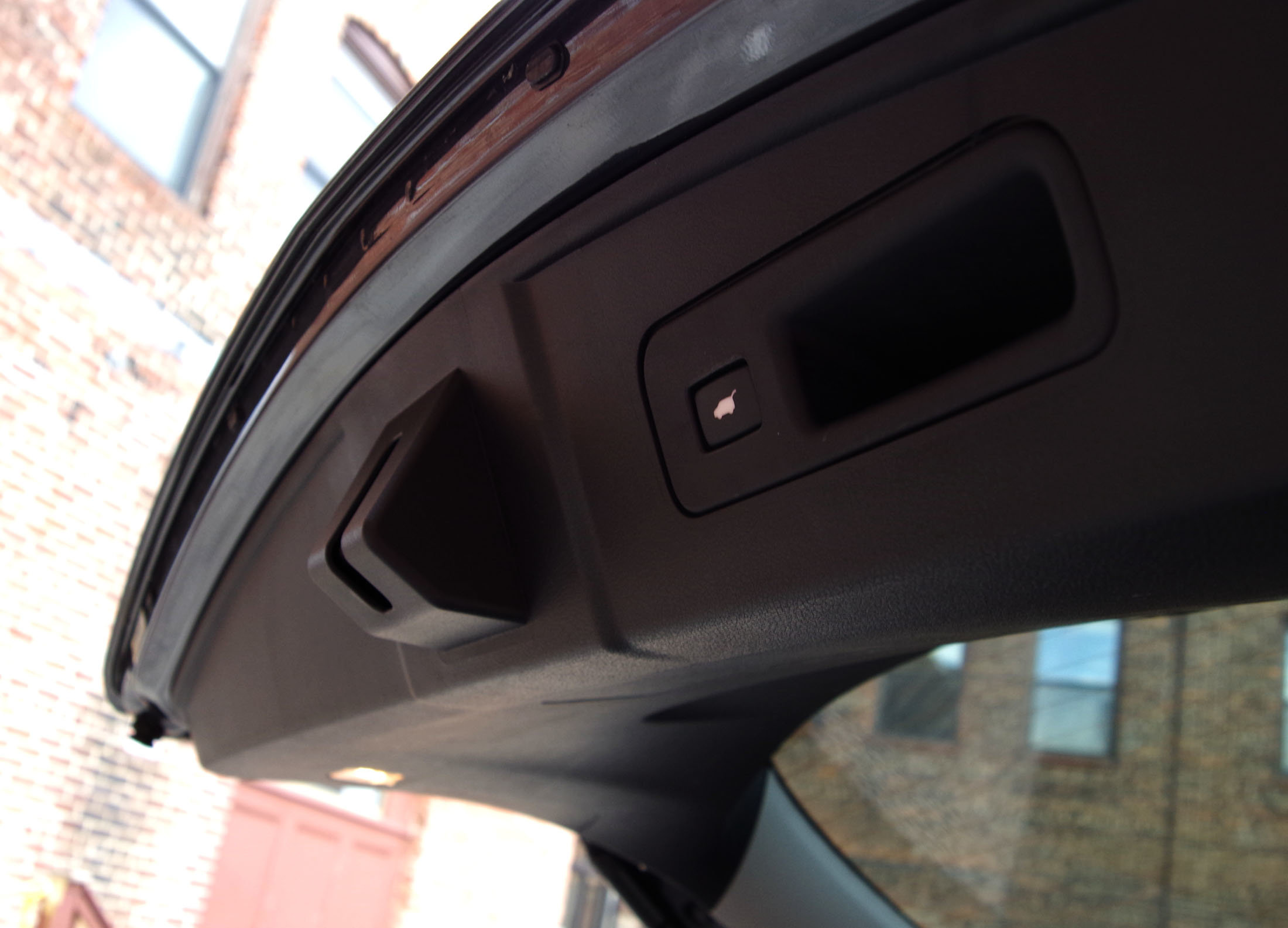 The trunk opens and closes automatically at the touch of a button.