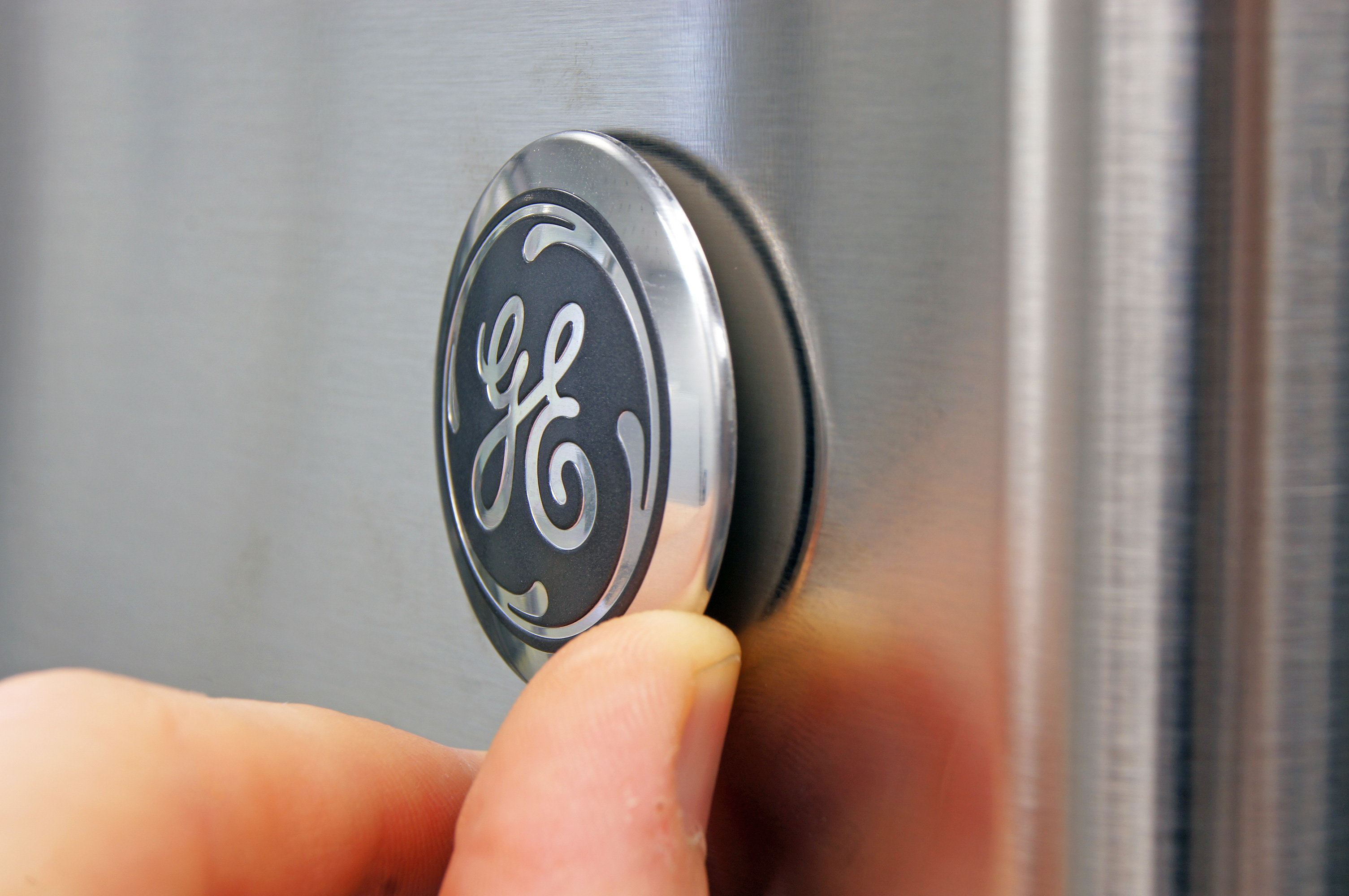 The GE GTE16GSHSS's doors are reversible, so you have to attach the GE logo yourself. Trouble is, it won't necessarily sit flush to the door.