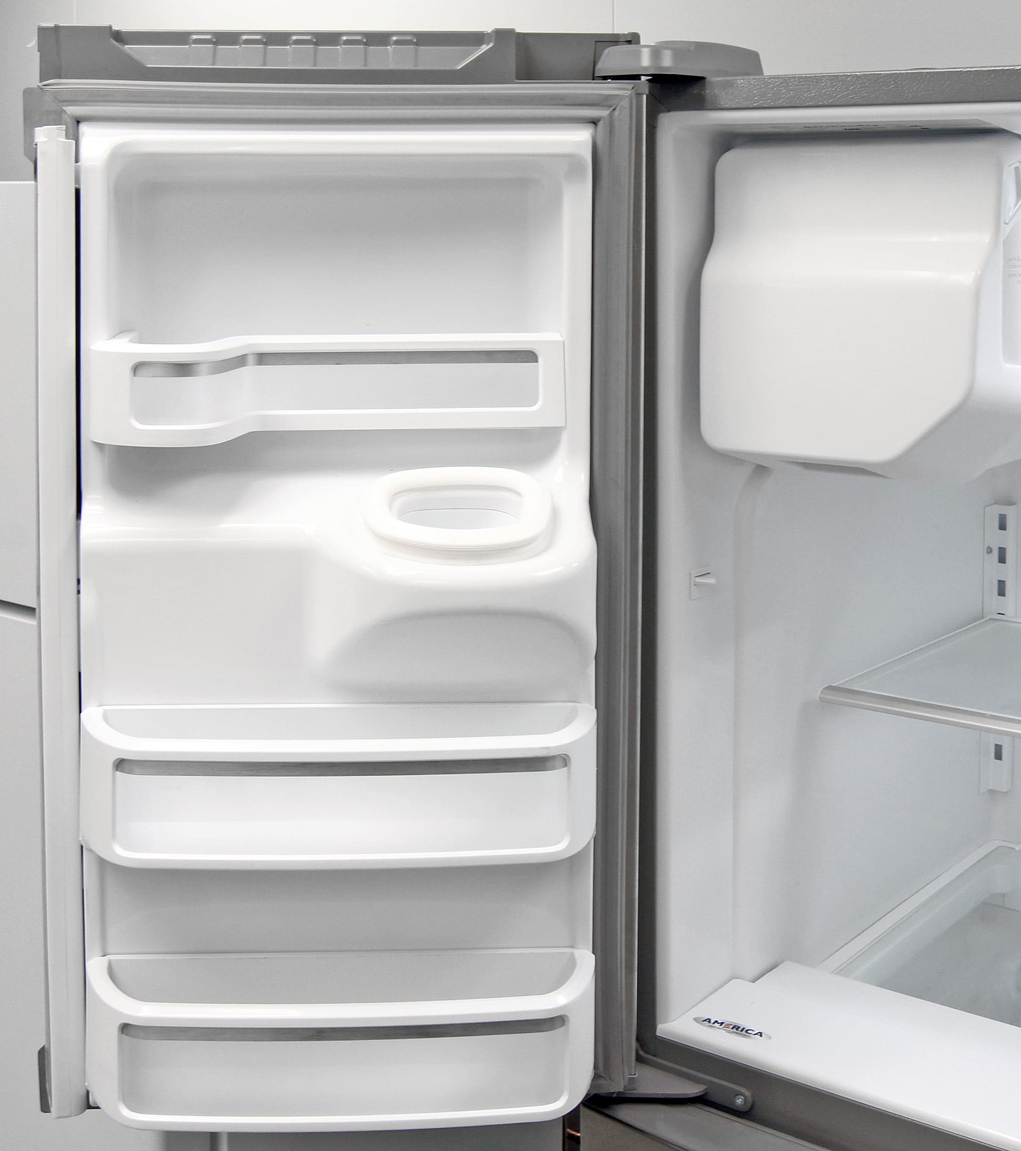 Storage on the left fridge door is distorted to accommodate the KitchenAid KFXS25RYMS's ice dispenser chute.