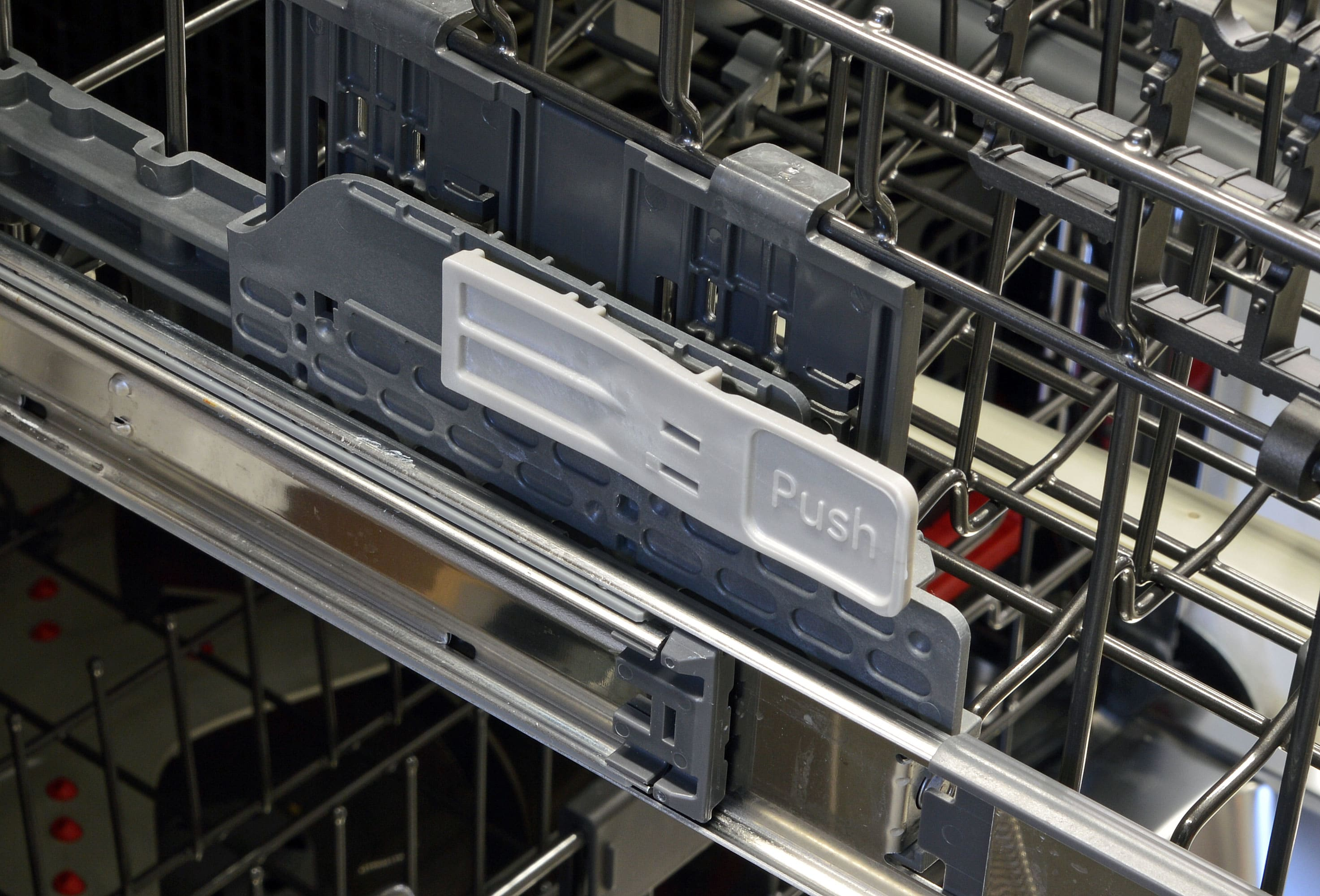 The upper rack's height can be adjusted using the handles on the side.