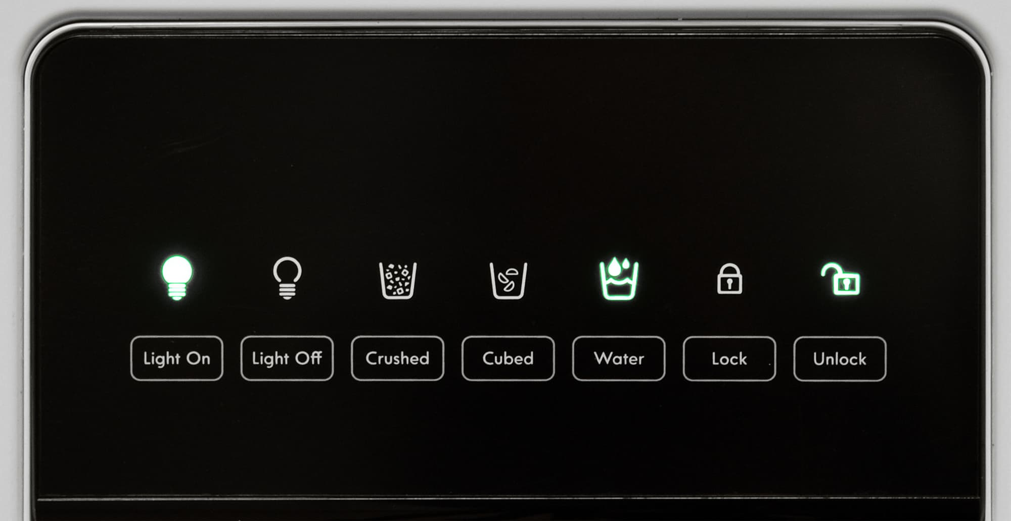 The Kenmore 51122's water controls look like a touch screen, but there are actually switches hidden behind that black plastic.