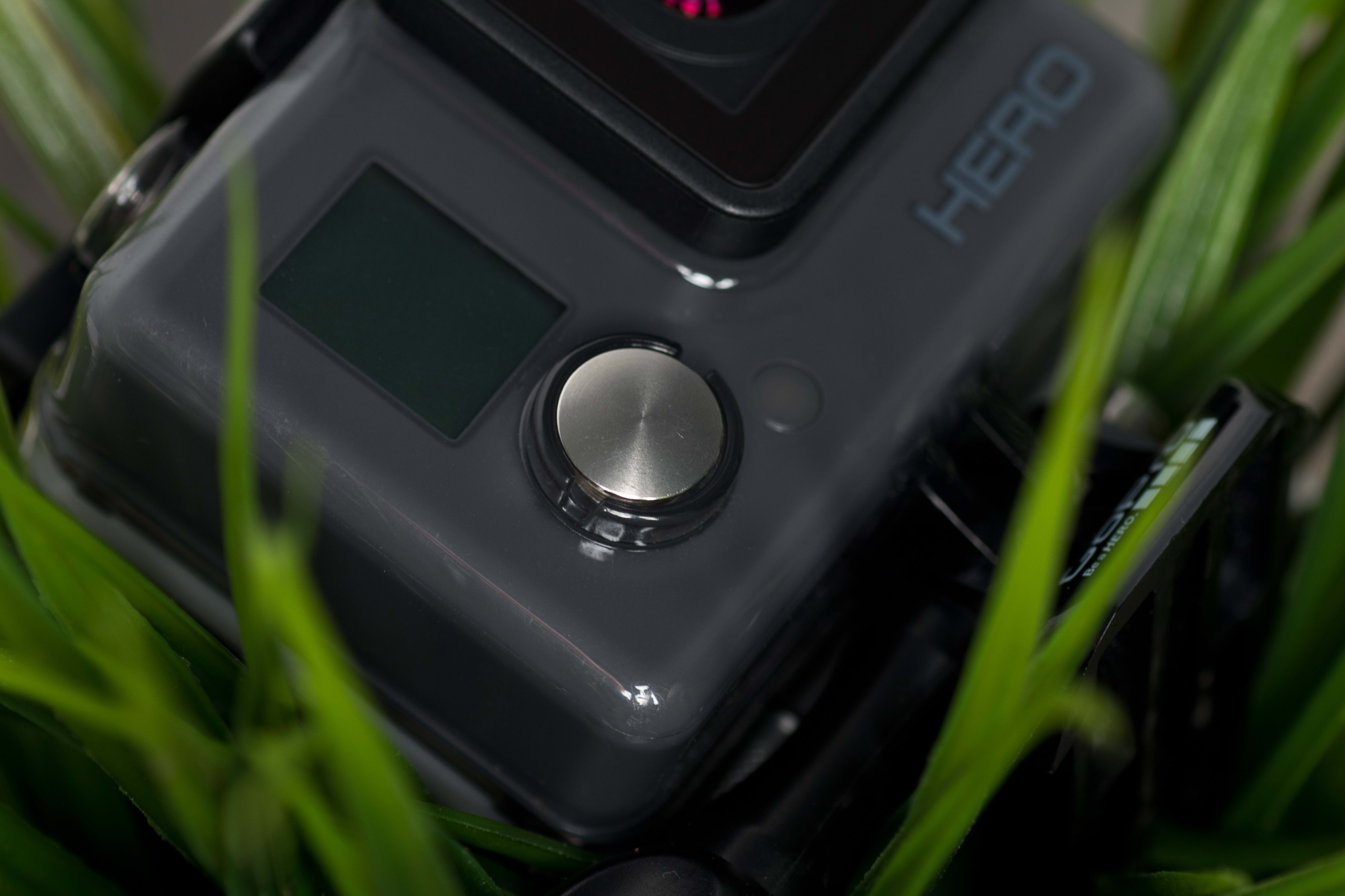 A photograph of the GoPro Hero 2014 edition's record button.