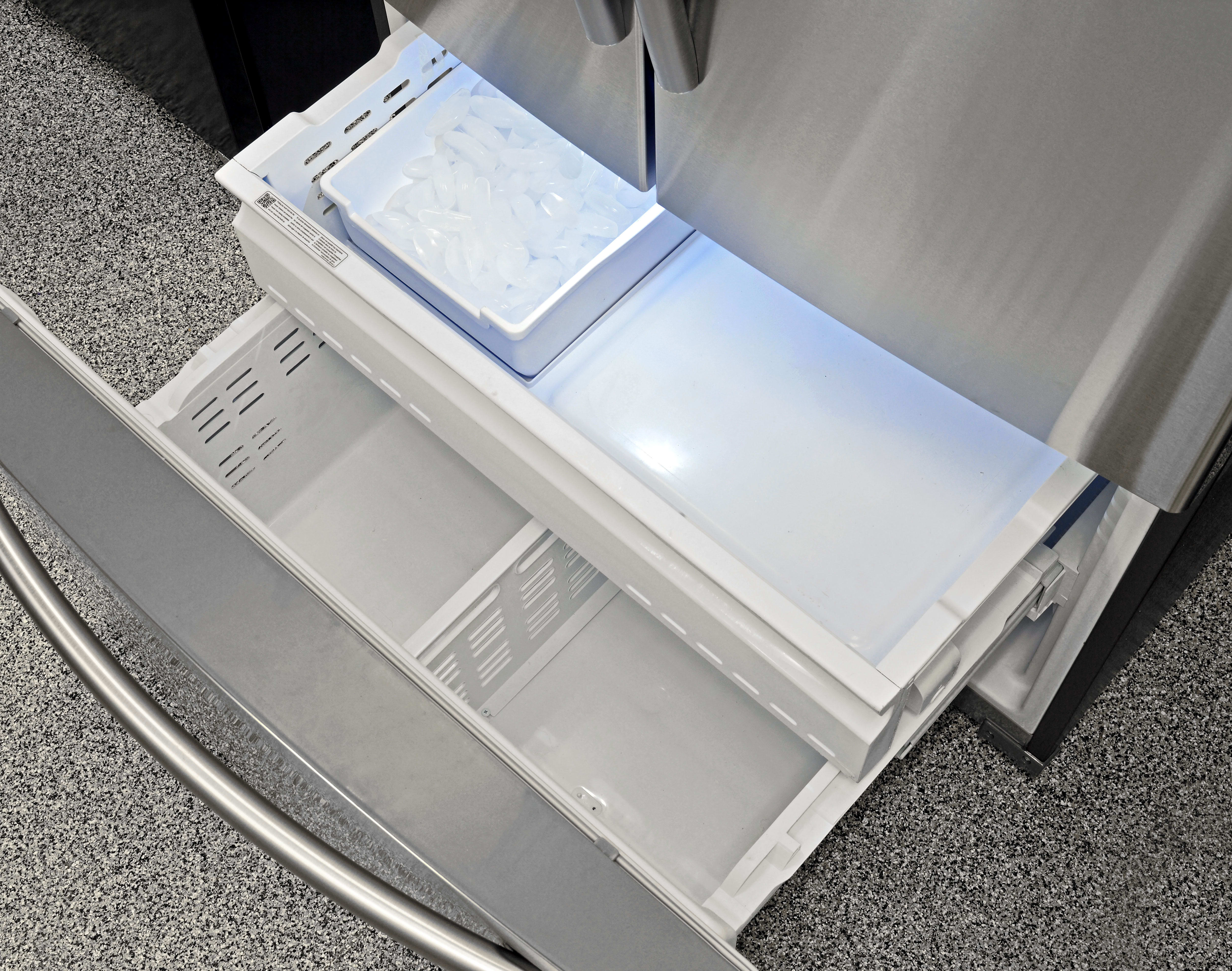The Samsung RF260BEAESR's pull-out freezer is spacious, and contains an ice maker with removable bucket.