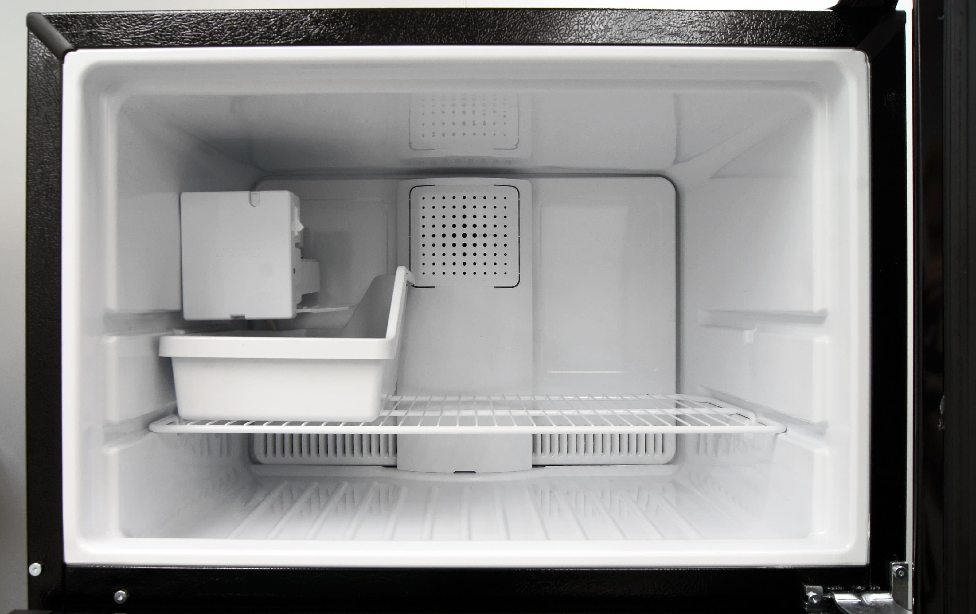 If you want to use the GE GIE16DGHBB's icemaker, you'll have to keep the freezer shelf in its lower slot.