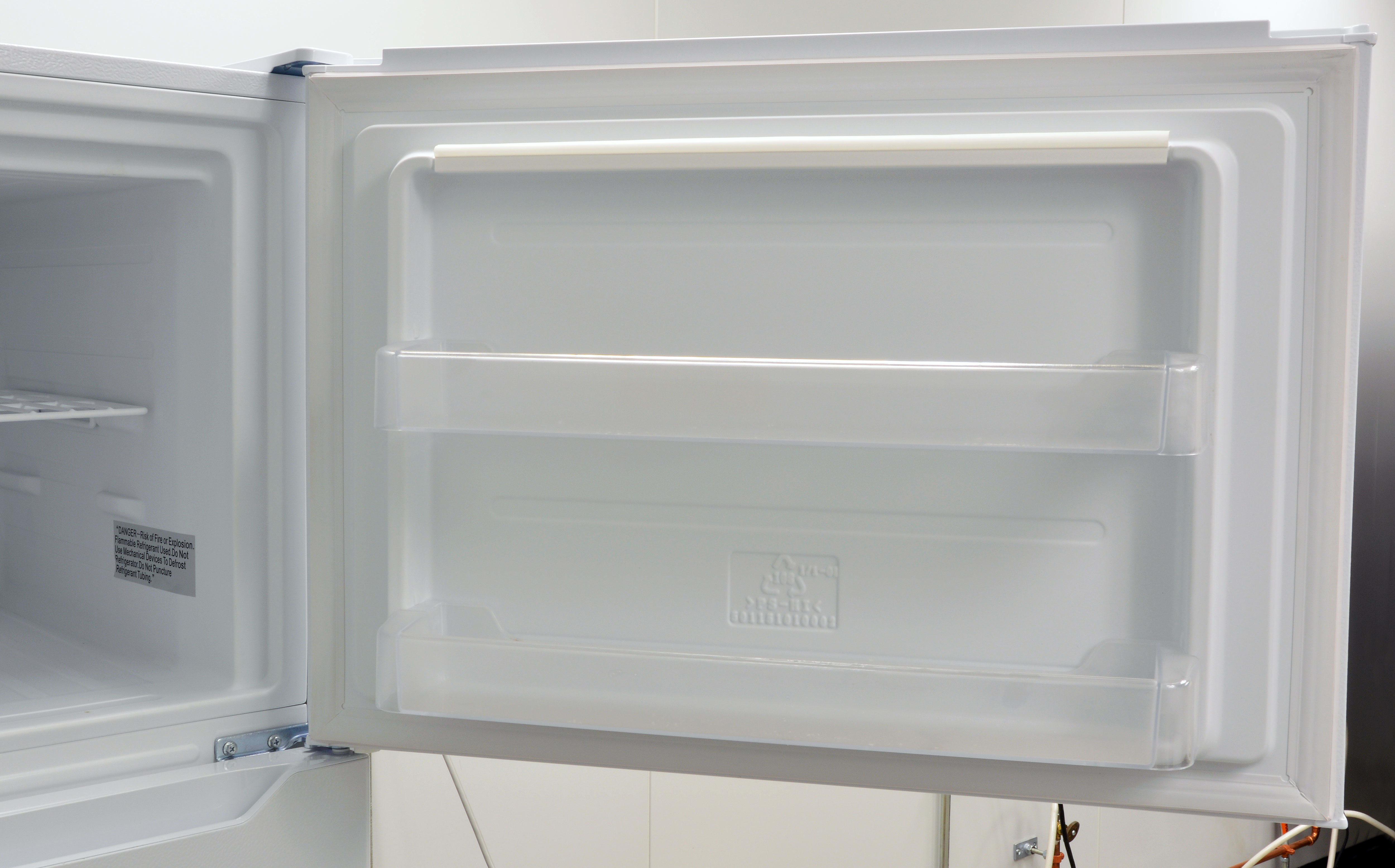 Some shallow door shelves supplement the freezer.