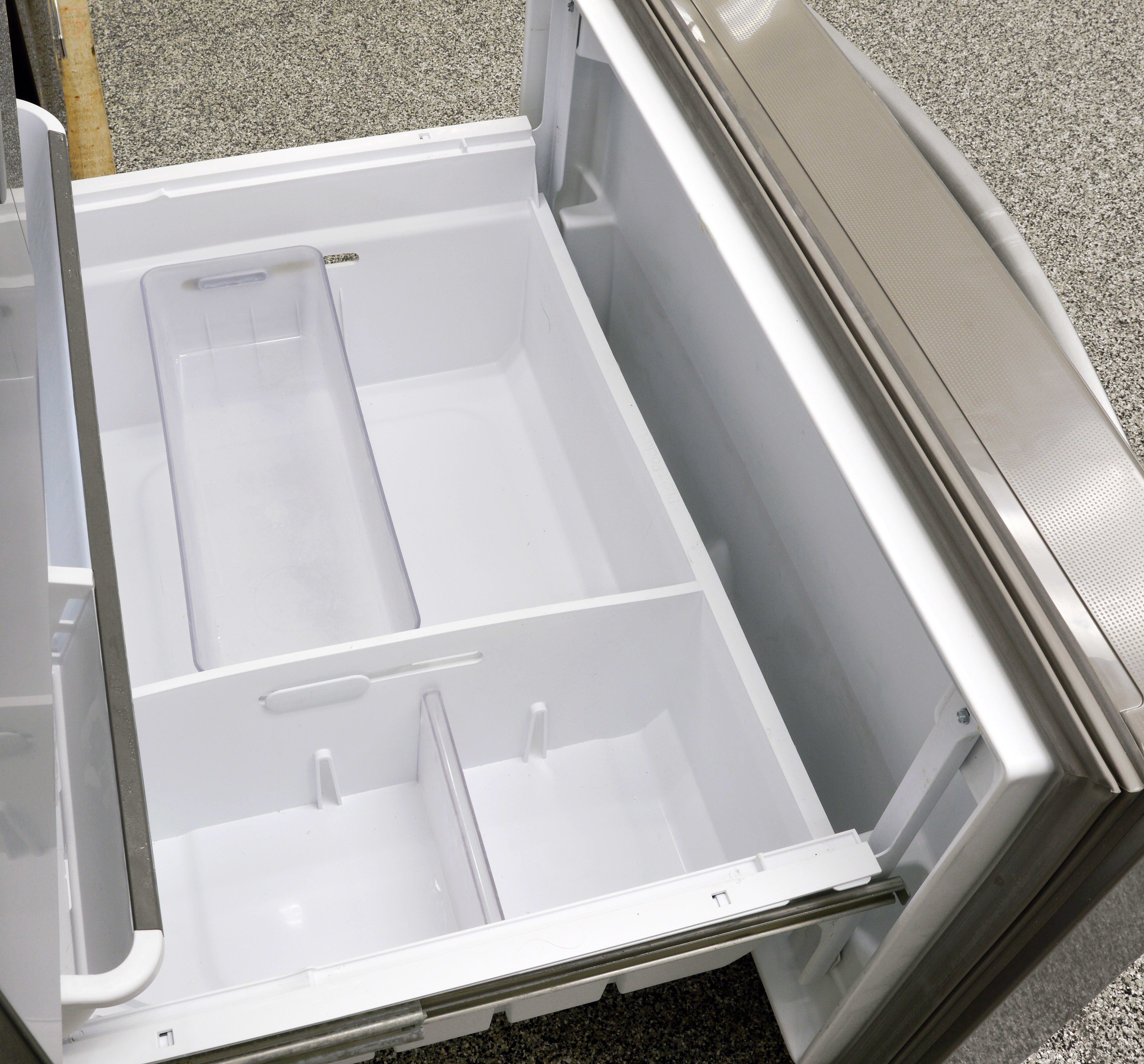 Just inside the freezer door is a Pizza Pocket, ideal for storing thin items that are tall or wide and might not fit well in the drawers.