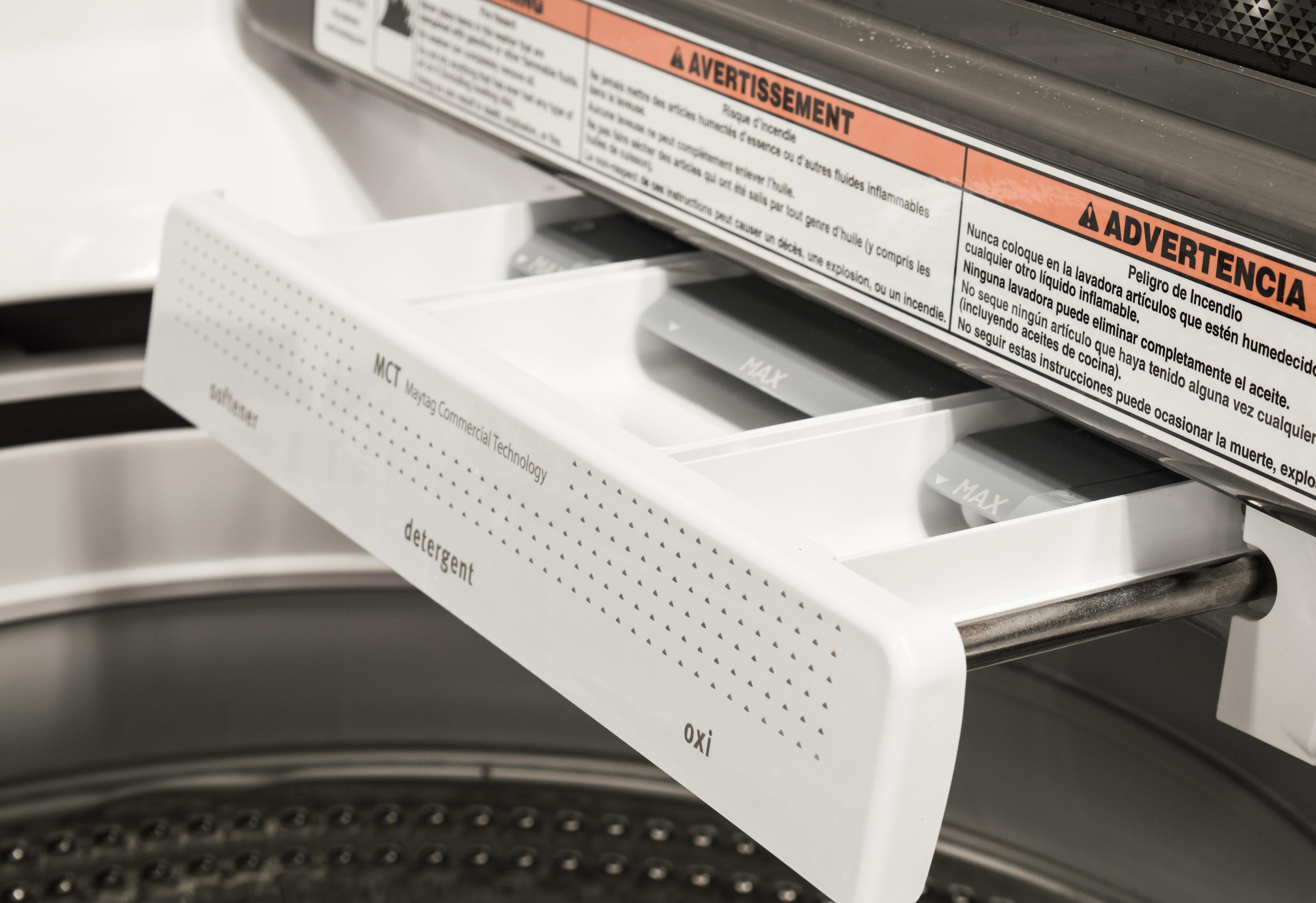 Metal rails lets the detergent dispenser open smoothly.