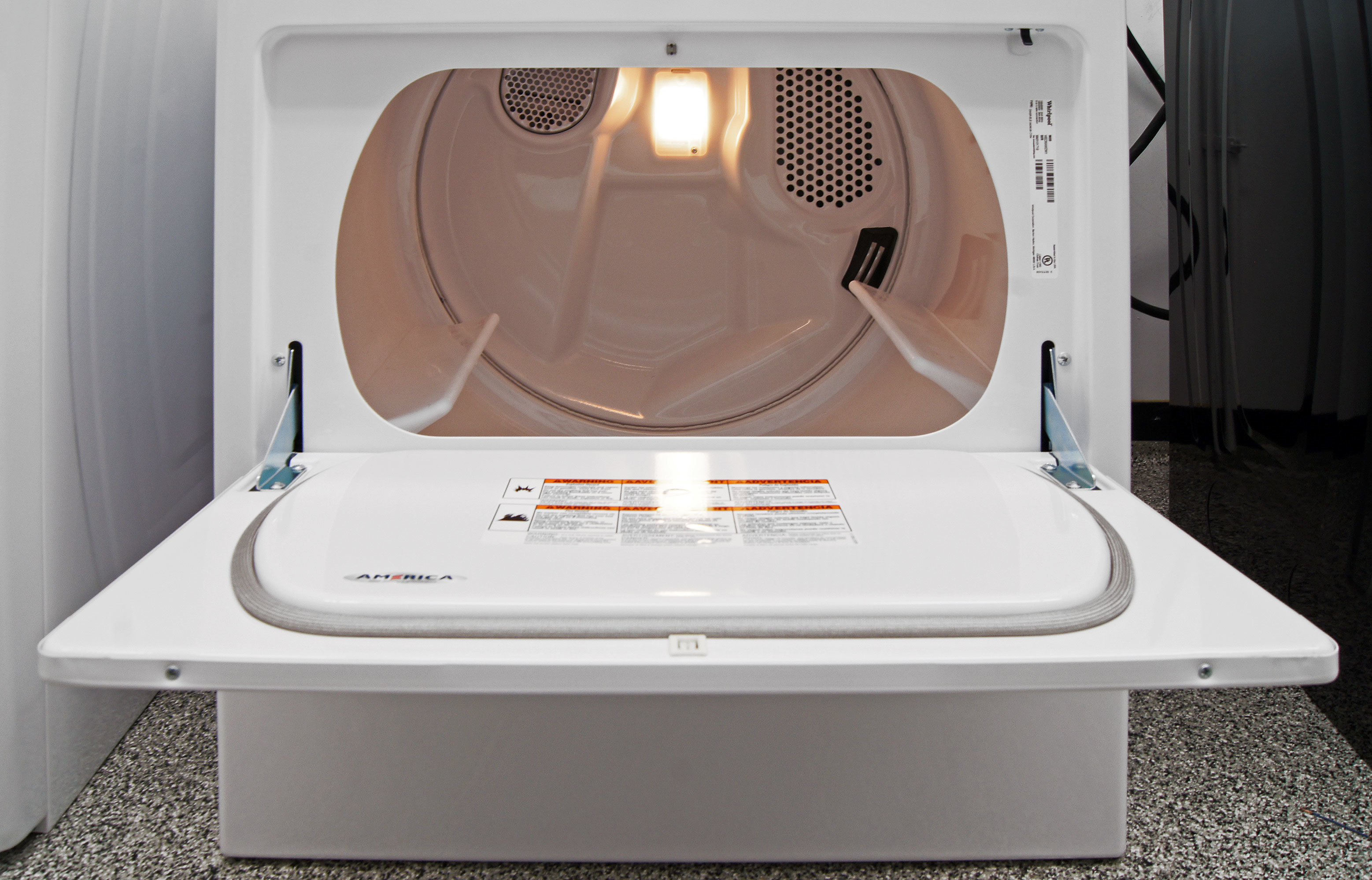 The Whirlpool WED4915EW's hamper door give you something to rest your basket on while folding laundry.