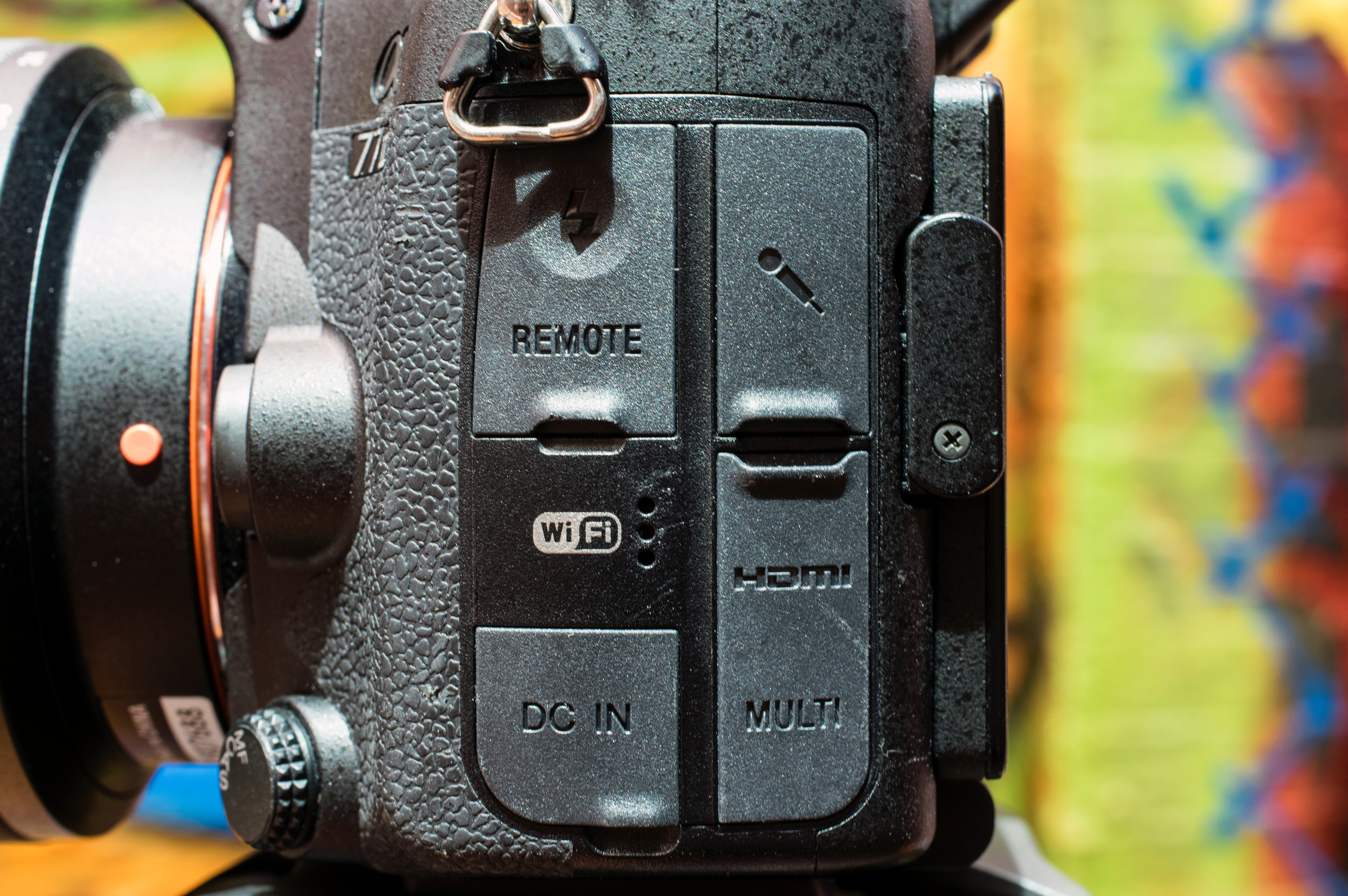 The A77II offers many ports including DC IN, HDMI, USB, and a mic jack.