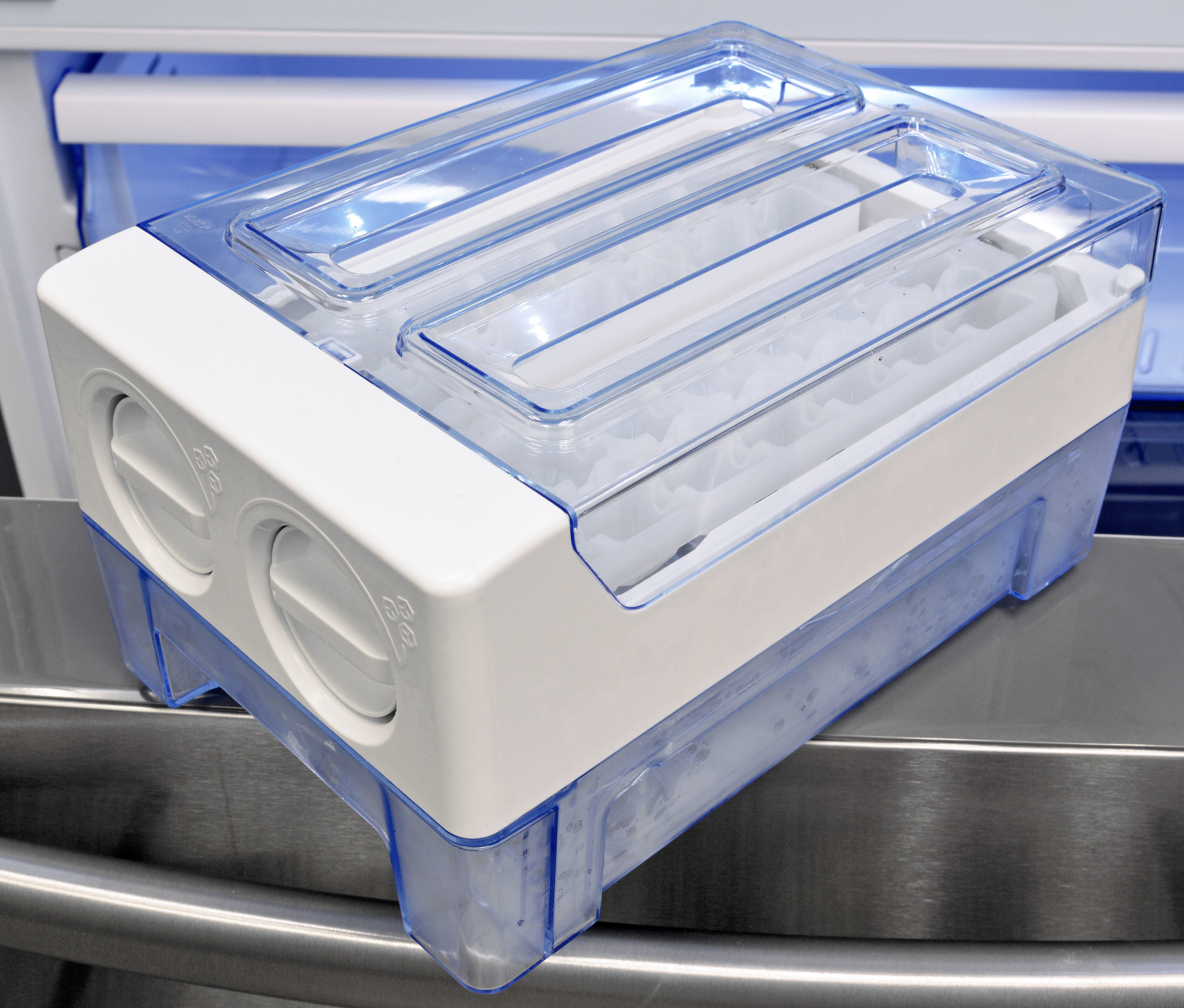 "The Hisense RF20N6ASE's ""ice maker"" is really just a glorified cube tray—fill with water, twist when frozen, and you get a small bucket of cubes."