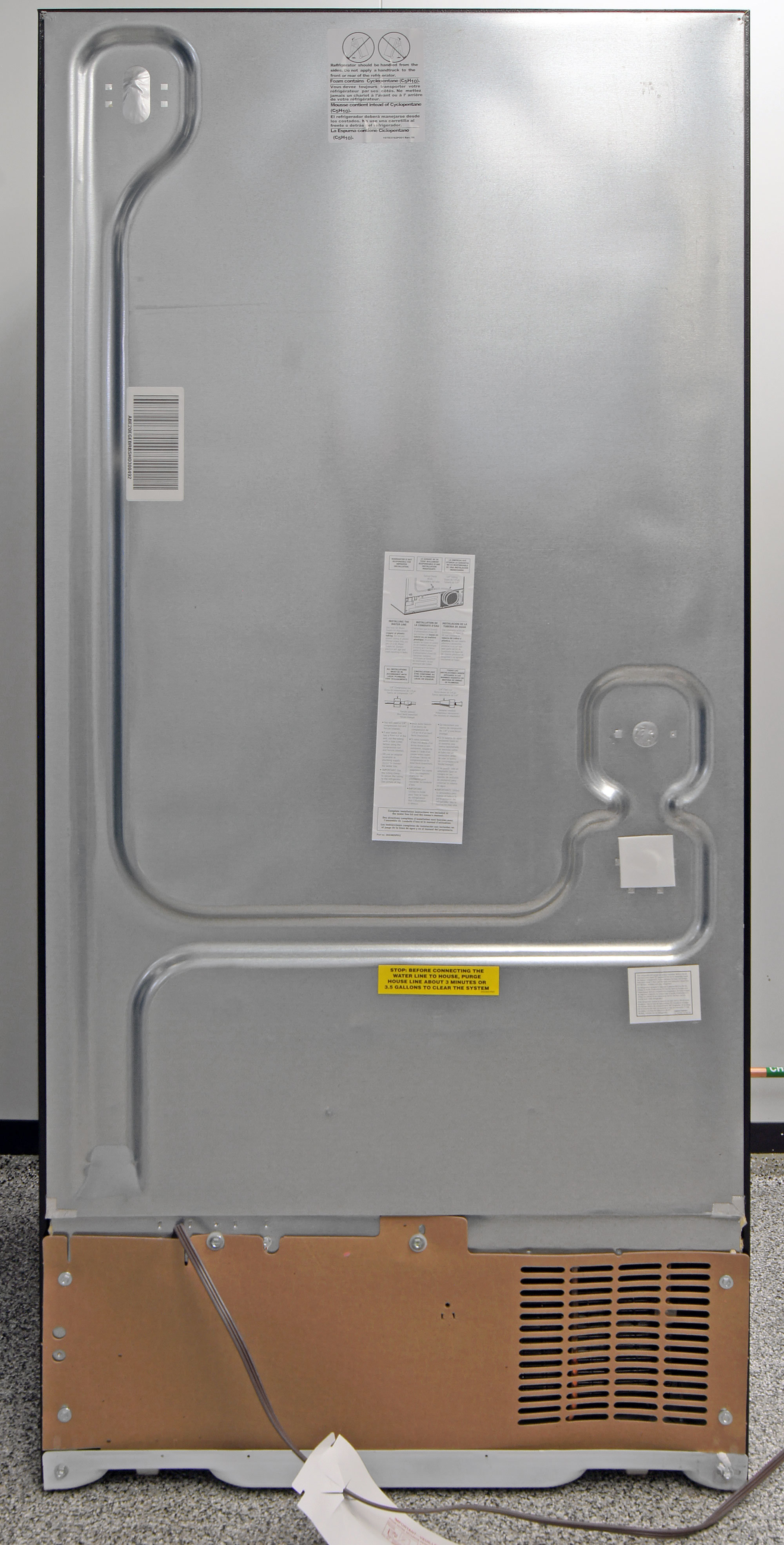 Without a water hookup, the only item of interest in back of the GE Artistry ABE20EGES is the power cable.
