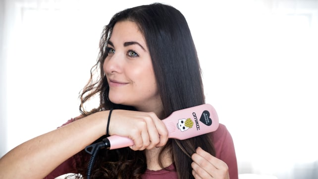 This top-selling Sephora thermal hair brush by Amika straightens my hair in half the time