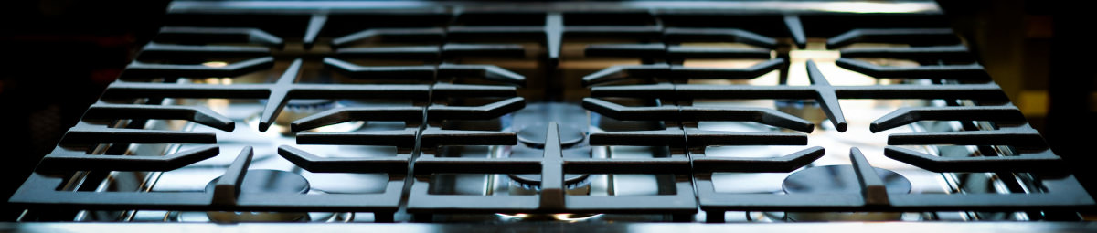 kenmore iron. the cast iron grates are dishwasher safe, so clean up should be a breeze. kenmore